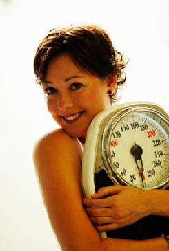 happy woman who lost weight with hypnosis